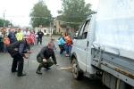 Перетягивание автомобилей детьми в День строителя. Фото_18